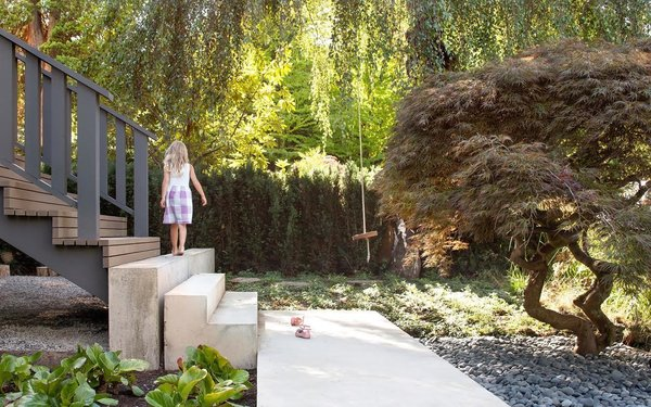 """The backyard's emphasis on nature is mirrored in the front of the home, which also underwent extensive landscaping by Considered Design. The owners and Parish wanted to """"tone everything down"""" and turn the home into a backdrop for a natural setting. Photo 20 of Trotman Residence modern home"""