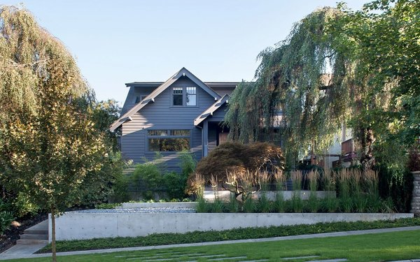 The whole exterior of the home, including the trim, is painted Wrought Iron by Benjamin Moore for a monochromic, quiet look. Photo 19 of Trotman Residence modern home