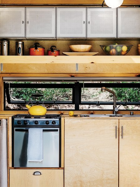 Dwell a tiny diy trailer home built by a couple on a budget Maximize kitchen storage