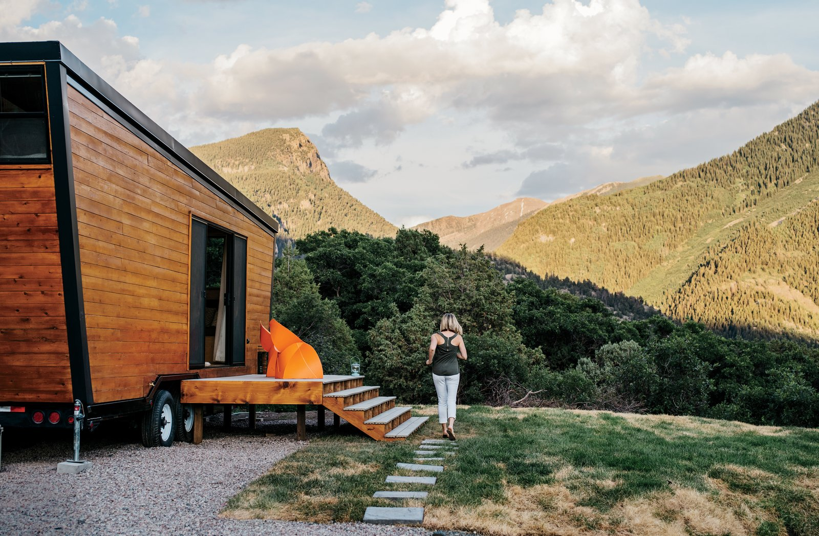 Brian and Joni Buzarde's self-designed home sits on a customized chassis by PJ Trailers that's just eight and a half feet wide. The 236-square-foot trailer is clad in cedar. Tagged: Field, Exterior, and Wood Siding Material.  Photo 2 of 13 in How to build a Tiny DIY Trailer on a Budget