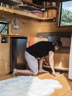How to build a Tiny DIY Trailer on a Budget - Photo 4 of 12 - The birch-plywood cabinets, floor storage space, and banquette were all designed and built by the couple.