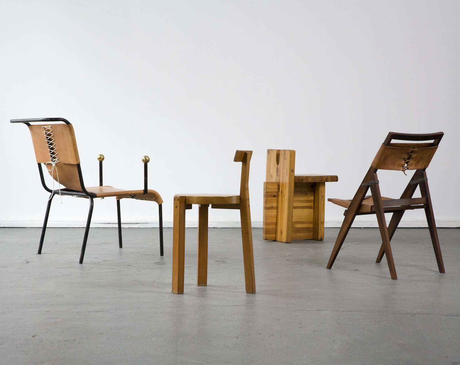 Architect Lina Bo Bardi embraced the vernacular design traditions while pushing new forms forward. Her use of not only wood but fabrics and leathers stand out in several of her designs. Her furniture was often designed only for her buildings. This group of chairs was created between the 1950s and the 1980s.  100+ Best Modern Seating Designs by Dwell from Bring the Best of Brazilian Modernism to Your Home with This New Book