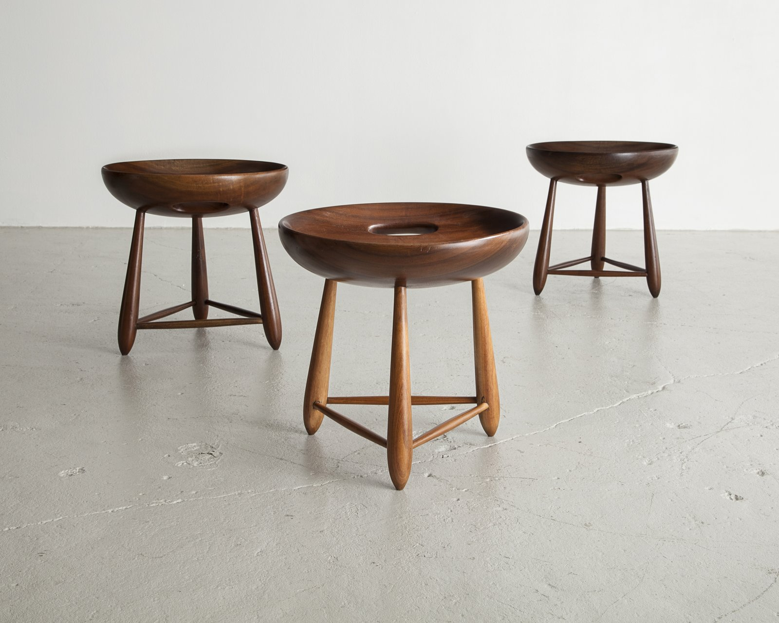 With signature materials like leather and wood, Sergio Rodrigues injected warmth and softness into his version of modernism. Here is a set of three-legged milking stools in Brazilian hardwood designed for Oca in 1954.  100+ Best Modern Seating Designs by Dwell from Bring the Best of Brazilian Modernism to Your Home with This New Book