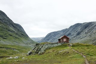 "101 Best Modern Cabins - Photo 12 of 101 - Anka Lamprecht and Lukas Wezel shared their rustic domicile in a valley in Grotli, Norway. Boasting an enviable view, it's the first cabin archived in the book's ""Backcountry"" category that features homesteads in the wilderness."