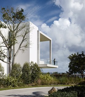 10 Works of Architecture That Reveal the Acrobatic Wonders of Concrete - Photo 8 of 10 - Jutting out over the landscape below, the cantilevered deck at the home of filmmaker-turned-designer Alejandro Landes looks out at Biscayne Bay in Miami's Coconut Grove neighborhood. Designed by Zyscovich Architects, the slim proportions of the porch seem to elude gravity while the subtle texture of the concrete provides a contrast to the smooth surface of the rest of the house.