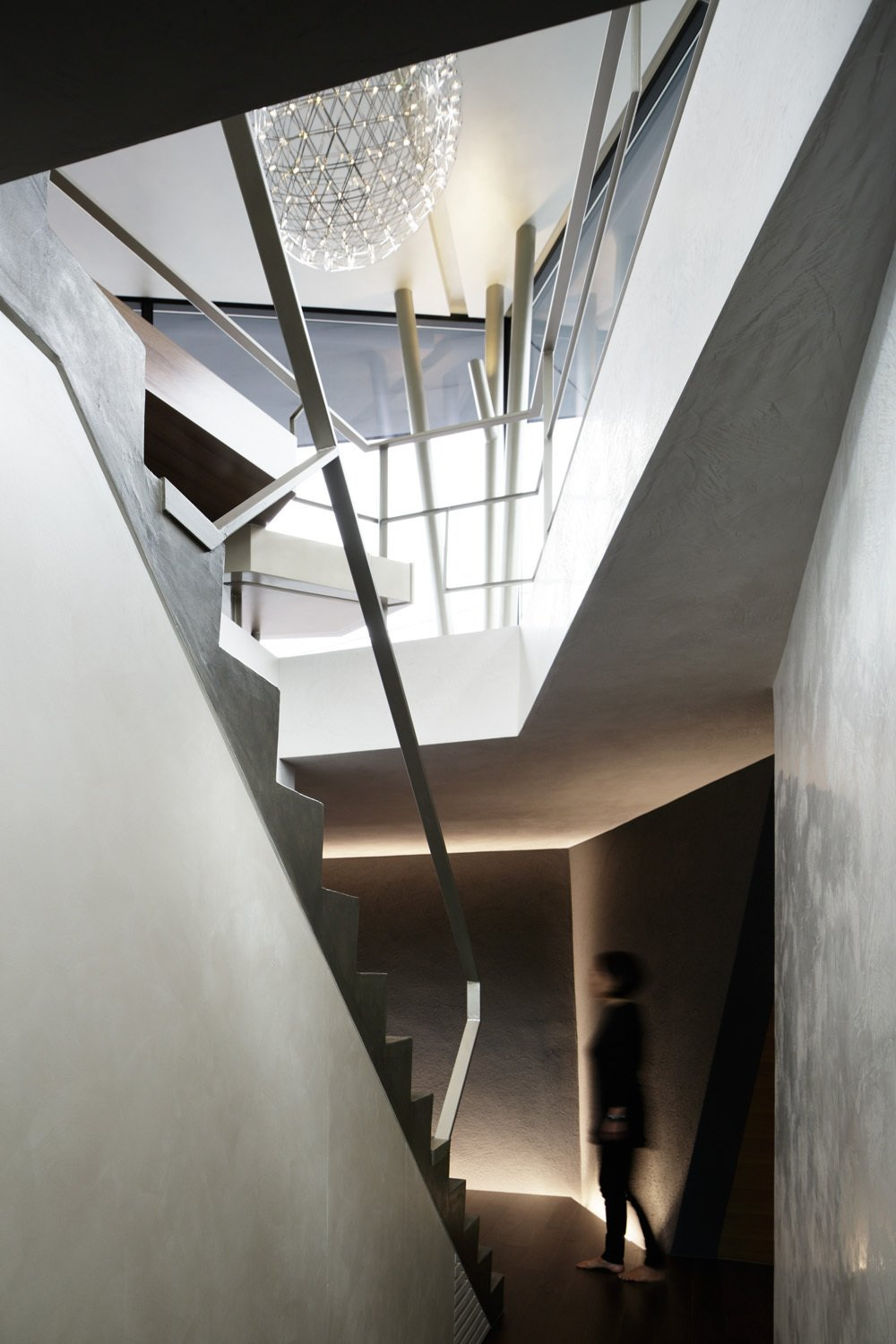 The challenge of building as angular a house on a 12 ft grade was visualizing how various vertical and horizontal planes would meet. The staircase serves as the backbone of the plan.