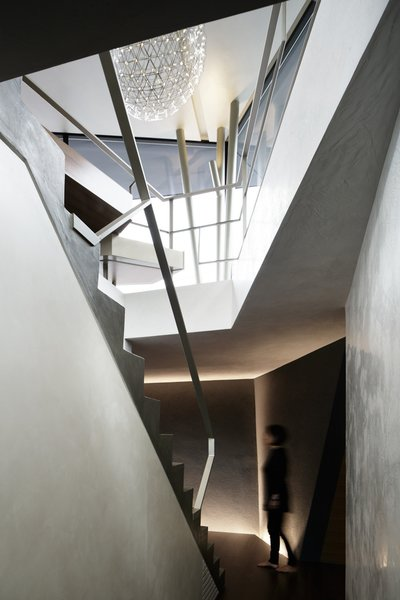The challenge of building as angular a house on a 12 ft grade was visualizing how various vertical and horizontal planes would meet. The staircase serves as the backbone of the plan. Photo 2 of SRK modern home
