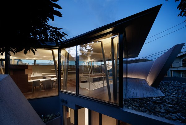 The architects describe the upstairs views as transporting the residents to a rocky mountain. Photo 8 of SRK modern home