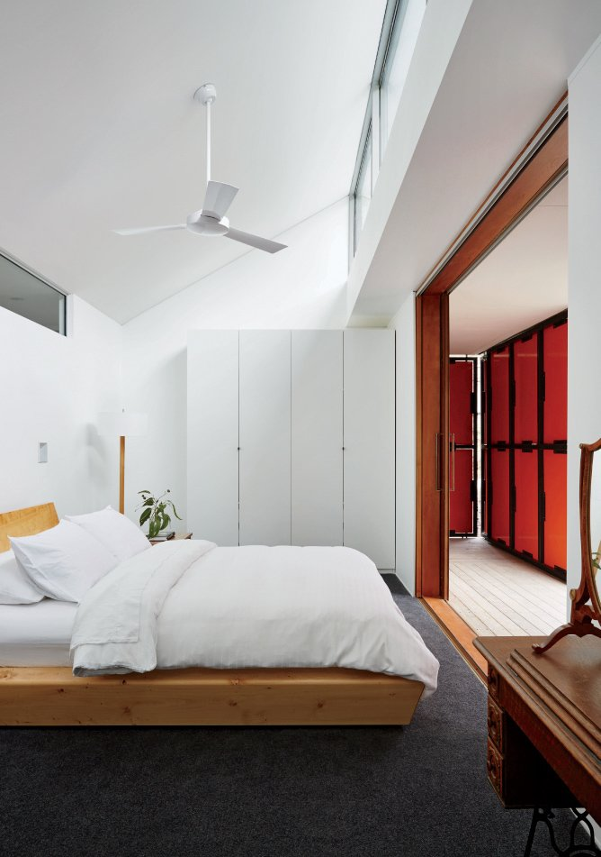 A wardrobe from IKEA and a bed by Rye Dunsmuir outfit one of two bedrooms.  Photo 10 of 10 in An Off-the-Grid Prefab that Combines Open Plan Living with Rugged Durability