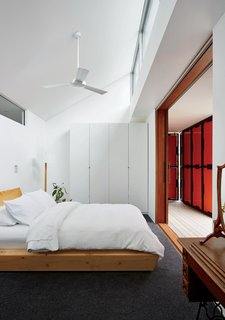 An Off-the-Grid Prefab that Combines Open Plan Living with Rugged Durability - Photo 10 of 10 - A wardrobe from IKEA and a bed by Rye Dunsmuir outfit one of two bedrooms.