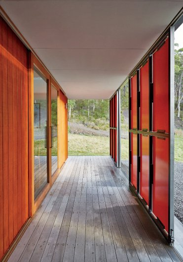 Both sets of panels slide open for maximum views and solar gain; in inclement weather, they shutter completely, while clerestory windows bathe the space in light.