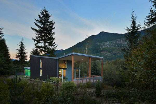 """The jagged edges of the roof are meant to resemble the surrounding peaks of the Cascades. The exterior HardiePanel vertical siding is painted """"dark pewter"""" by Benjamin Moore."""