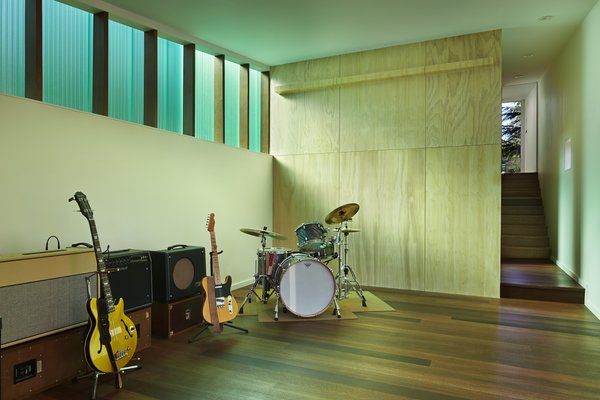"""The 1,000-square-foot studio includes a wood shop and music room. The Red Balau wood flooring was treated with Osmo color oil and Osmo Polyx finish. The walls are painted """"white heron"""" by Benjamin Moore."""