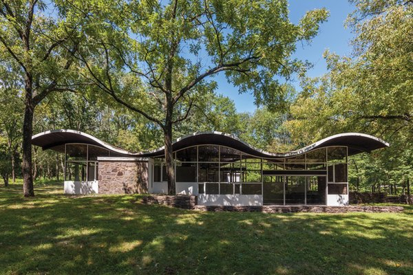 The Gregory Residence is a masterclass example in design. Furnished by renowned New Hope woodworker George Nakashima, this private and rustic home offers ingenious versatility over its 1,644 square feet of space on a 10-acre lot.