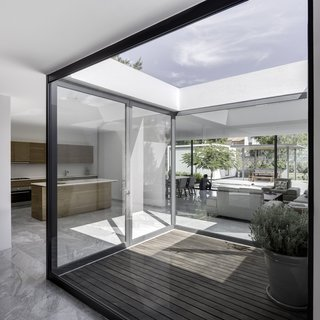 A Minimalist Mexican Retreat Uses an Array of Strategies to Beat the Heat - Photo 7 of 7 - This enclosed patio within one of the modules invites residents to enjoy the outdoors while still protected from the intense heat. The dining room table and chairs designed by Hector Esrawe.