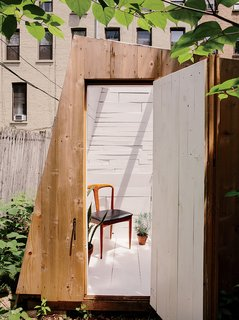 An Architect Builds His Own Backyard Oasis From Salvaged Materials - Photo 2 of 5 - The building's design was determined by the desire for a strong geometric form and by the materials Hunt could find. The cedar cladding is meant to fade over time.
