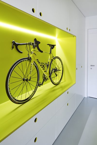 The owner is an avid cyclist; the guest apartment's hallway entrance features this unique storage space for his roadbike. Old damaged floors were replaced with a durable polyurethane coating.