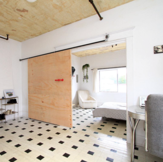 Photo of the Week: Simple Sliding Door Made of Spare Plumbing Parts - Photo 1 of 1 -
