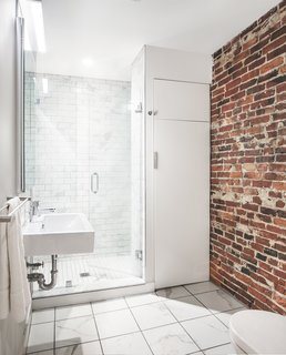 An Archaeological Renovation Adds Precious Space to a Tiny Boston Apartment - Photo 4 of 5 - Along with historic wood and steel details, several warm brick walls were exhumed and left exposed.
