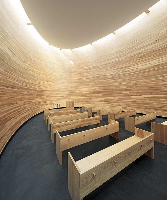 Known as the Chapel of Silence, the skylit, curved wooden structure is designed for quiet meditation.