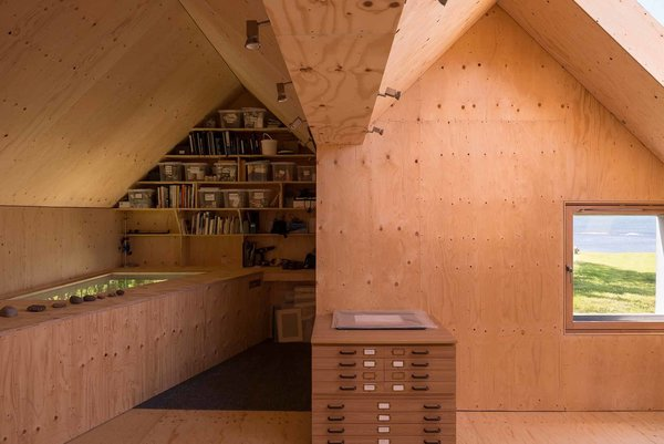 The studio's double-pitched roof is a nod to the traditional local architecture. Photo 5 of Midden Studio modern home