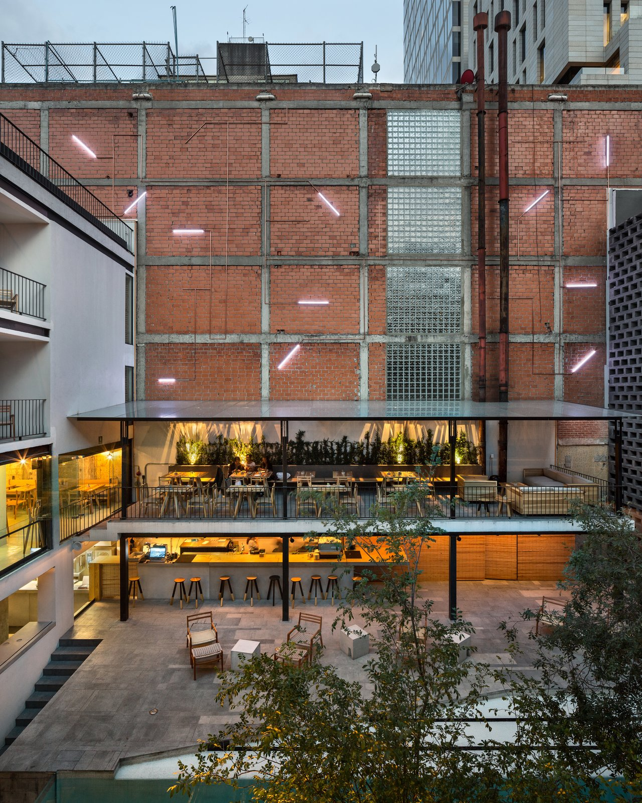 Today, as in the 1970s, the central courtyard is an oasis within the city. Along with a pool, the area is also home to a market-centric restaurant.  Photo 1 of 7 in This Mexico City Hotel is a Showcase of New Mexican Design