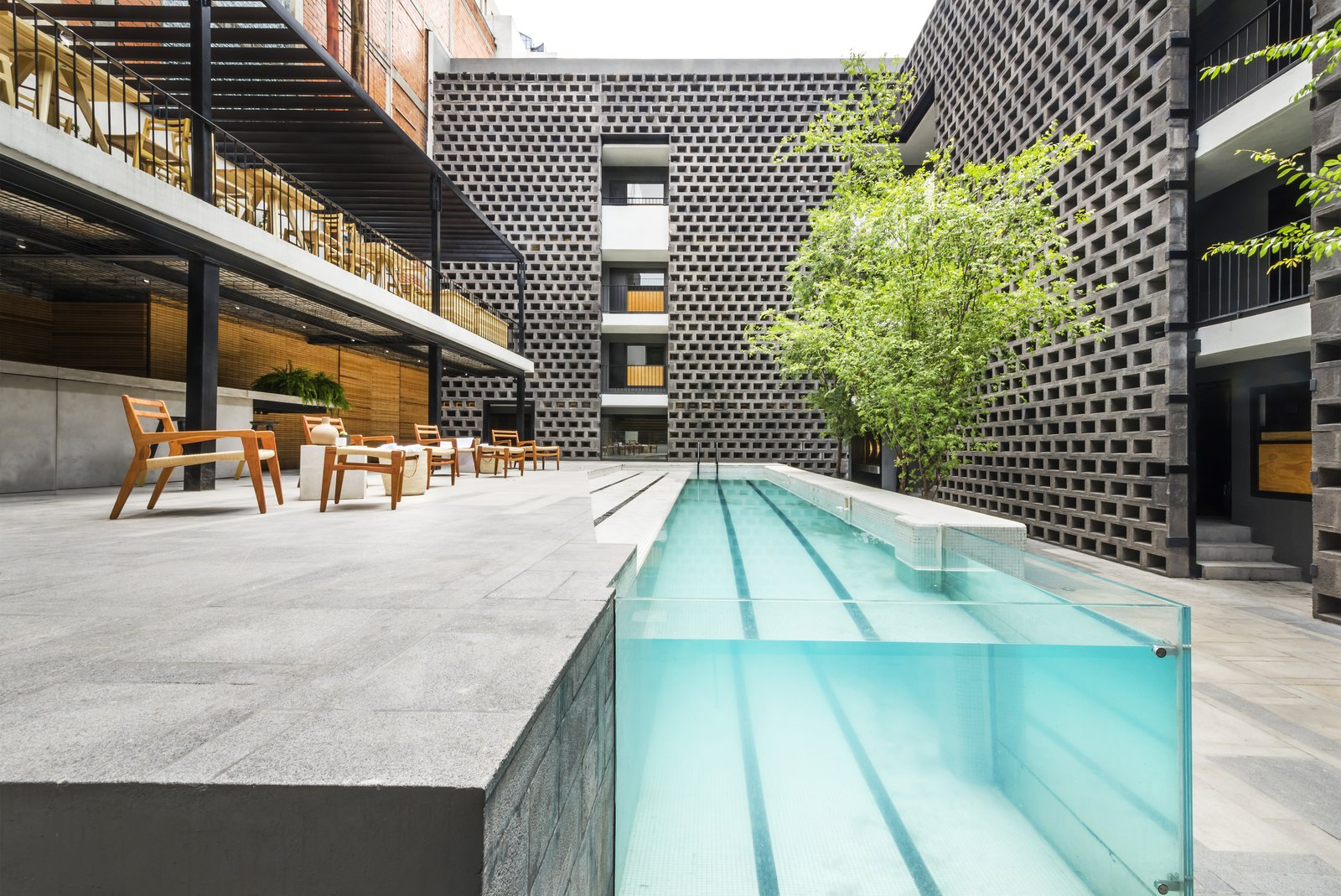 A pool is still the focal point of the courtyard, but its modernized, streamlined design makes a dramatic statement.  Photo 3 of 7 in This Mexico City Hotel is a Showcase of New Mexican Design