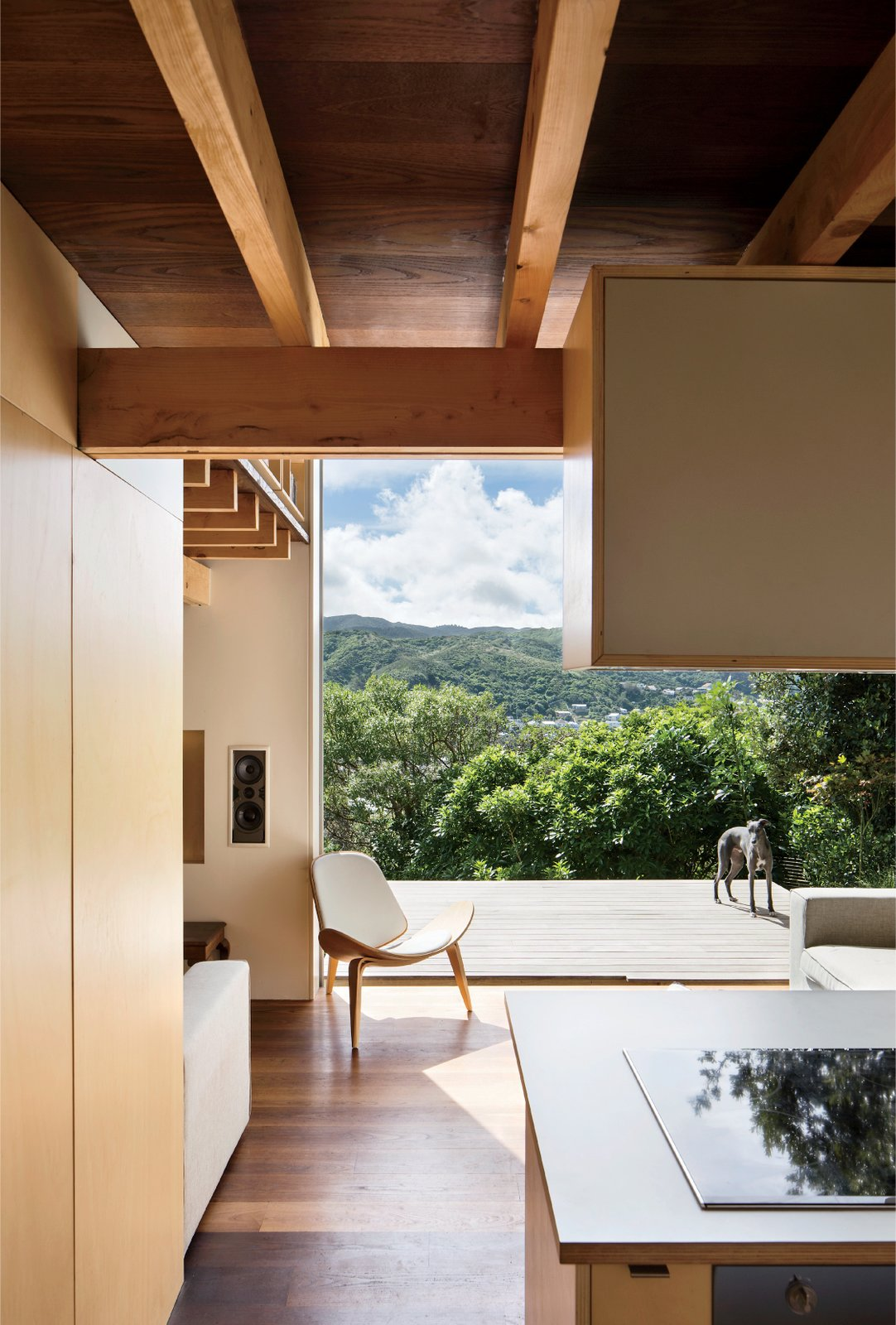 The home also extends into outdoor panoramas, even—and especially—from the ground floor, where a westward-facing deck cantilevers out into the lush landscape. Best Photos