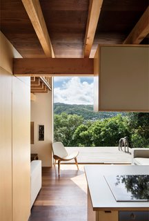 A Home's High Ceilings Are Responsible for Some Impressive Views - Photo 6 of 10 - The home also extends into outdoor panoramas, even—and especially—from the ground floor, where a westward-facing deck cantilevers out into the lush landscape.