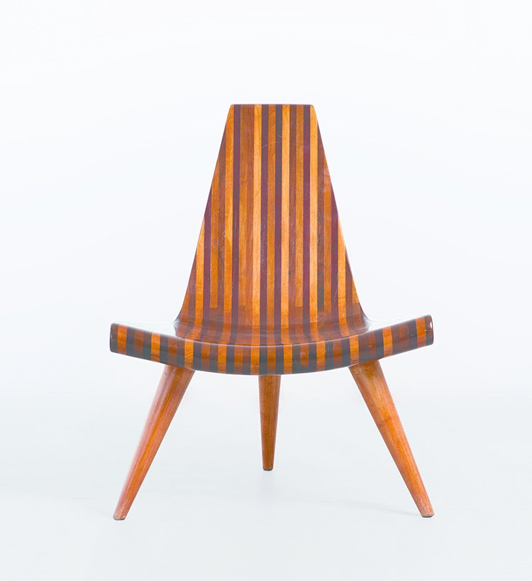 Striated shades of wood make up Brazilian designer Joaquim Tenreiro's three-legged chair from 1947.