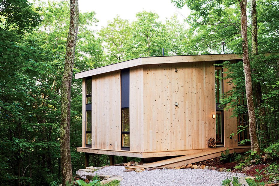 Those costs were partially recouped by using knotted pine planks for the exterior. Tagged: Outdoor, Slope, Woodland, and Trees. 101 Best Modern Cabins - Photo 61 of 101