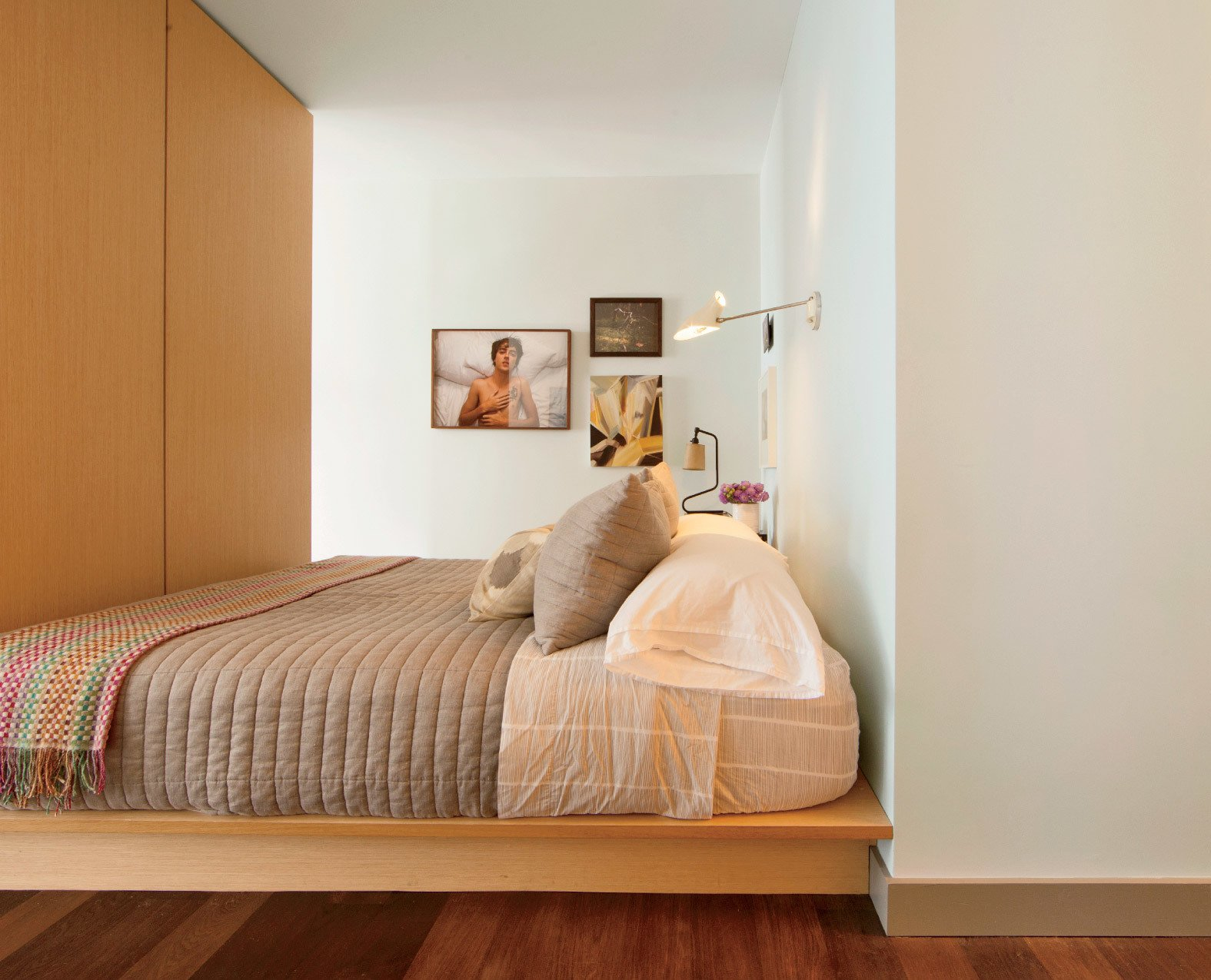 Dufner also designed the bed, which features storage panels under the mattress.  Photo 2 of 6 in This Luxurious Apartment in Greenwich Village Is Only 520 Square Feet