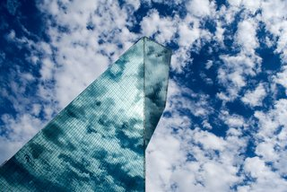 "Nikola Olic's Dizzying Architectural Photography - Photo 2 of 16 - Broken Building, 2014. I.M. Pei's Fountain Place in Dallas, Texas, built in 1986. ""He used angles, triangles, planes and prisms to create a seemingly impossible visual space with this building,"" says Olic. ""The view from the east makes the structure seem broken and folded down the middle."""