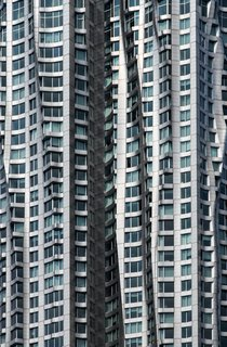 """Nikola Olic's Dizzying Architectural Photography - Photo 1 of 16 - Twisted Building, 2014. """"With its metallic waves and twisted reflections, this Frank Gehry masterpiece in New York City looks out of place in a beautifully unexpected way, seen here from the nearby Brooklyn Bridge,"""" says Olic."""