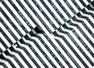 "Nikola Olic's Dizzying Architectural Photography - Photo 3 of 16 - Hypnotic Building, 2014. ""The saturated facade of this late-modernist 1981 office building in Houston, Texas, exposes the inner paths of its elevators, outlining the dramatic black-and-white lines with glass and aluminum,"" notes Olic."