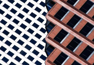 "Nikola Olic's Dizzying Architectural Photography - Photo 7 of 16 - Ripped Building, 2014. ""The angled top floors of this dark red office building in New Orleans, Louisiana, provide an interesting collage with the white building a few blocks down the street,"" says Olic. Combining the two is a simple photographic idea of a structure ripped into two distinct parts."""