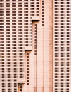 "Nikola Olic's Dizzying Architectural Photography - Photo 5 of 16 - Building With Steps, 2014. ""The tallest building in Fort Worth, Texas, this simple brutalist architectural design is a unique addition to the vibrant and growing downtown landscape, with a strong, repetitive pattern of windows being interrupted by meticulous, powerful vertical lines,"" says Olic."