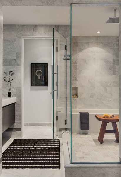 The master bathroom's marble tile wall is by White Venatino marble, with gray accent tile from Florim USA. A Wetstyle bathtub stands in the corner. Photo 7 of Back Bay modern home