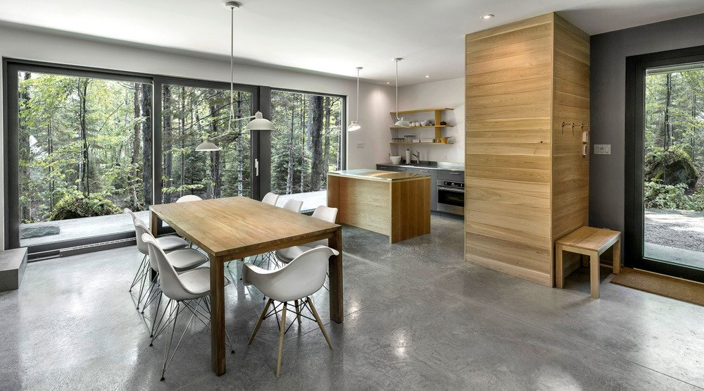 The firm's first home model for the development is dubbed Spahaus. Meant as vacation homes, the site's 21 cabins are designed to take advantage of the area's natural setting with large windows that overlook the forest.