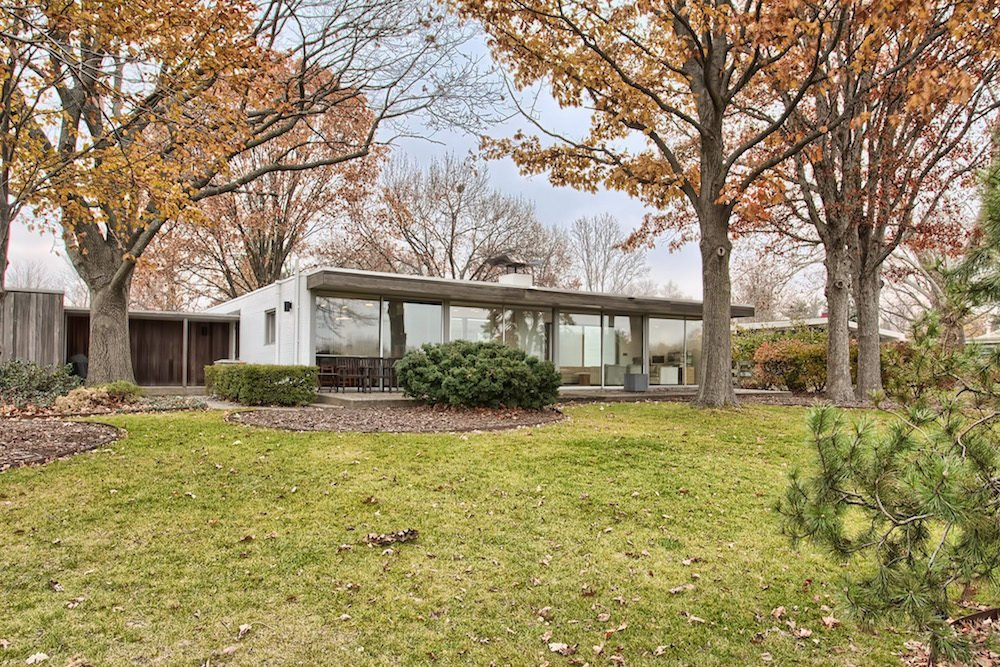 Architect: John Replinger  Location: Urbana, Illinois  Price: $296,000  Replinger may not be as hallowed a name as Kahn or Meier, but the 1960s-era one-story home he designed in Illinois a worthy descendant of Glass House-style American modernism. Bonus? It's already been meticulously renovated. [via Curbed]  Midcentury Homes by Dwell from Buy a Piece of American Modernism with These 8 For-Sale Homes