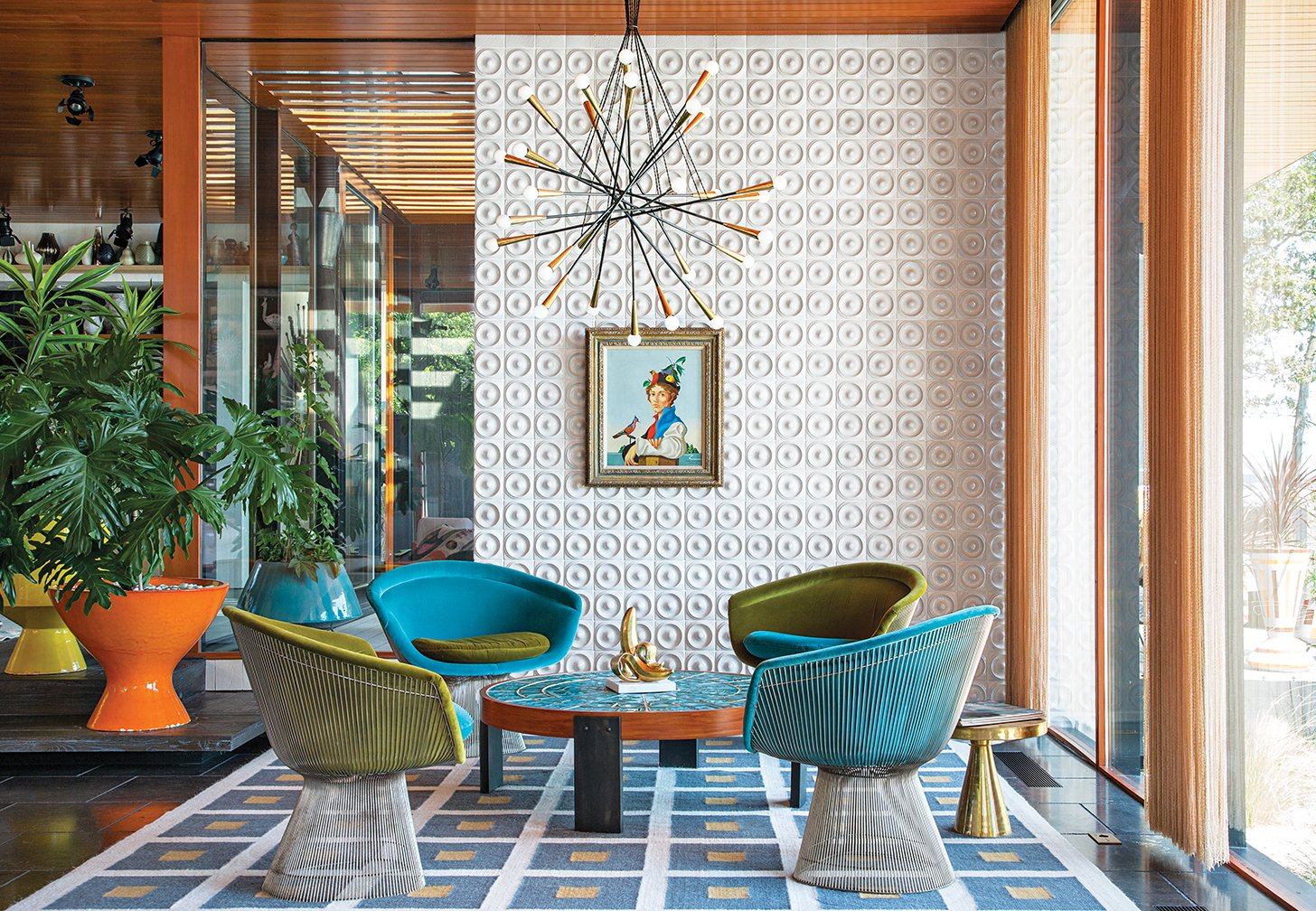 """There's no right answer except to play and experiment,"" says interior designer Jonathan Adler in regards to the Shelter Island getaway he shares with his husband, fellow design expert Simon Doonan. Custom ceramic wall tiles, a few plants, and a self-made rug, stool, and coffee table all add to the home's inimitable decor. Tagged: Living Room, Chair, and Pendant Lighting.  50+ Modern Tile Ideas for Walls, Floors and Ceilings by William Lamb from Spaces Transformed by Interior Plants"