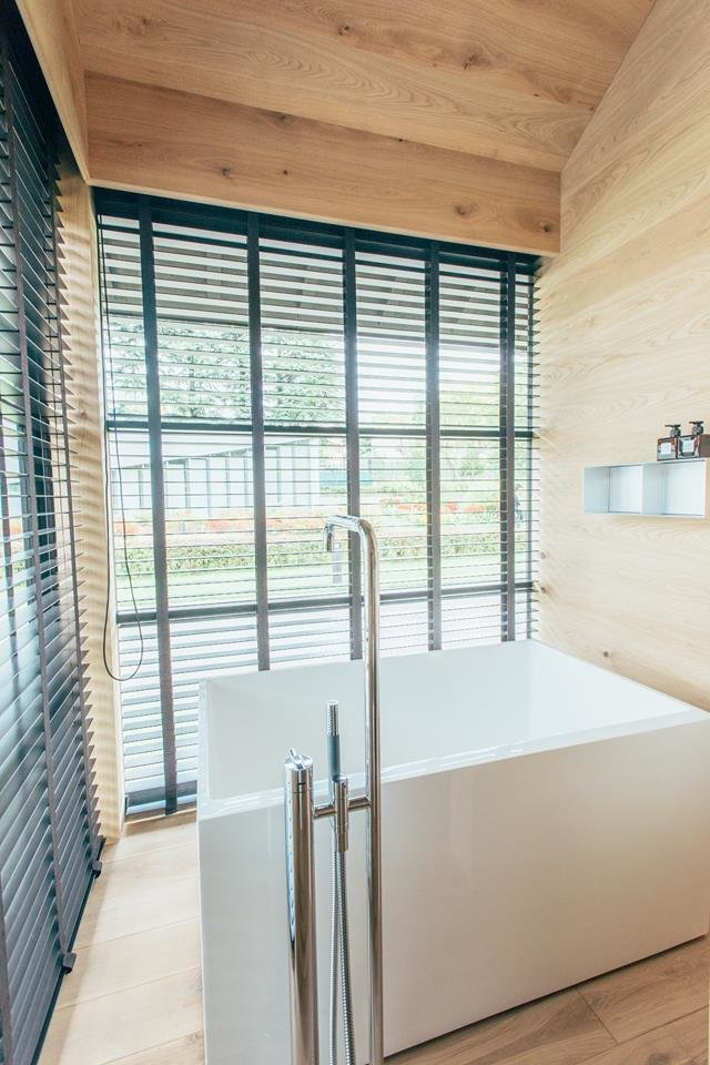 The main draw of Fukasawa's hut: a bathroom featuring a large, Japanese-style tub with a view.