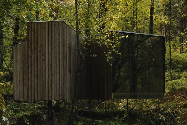 Designed by Jensen & Skovdin, the Juvet's first-generation cabins are built on stilts in order to impact the environment as little as possible. Despite the modernist aesthetic, the buildings were built by local craftsmen using traditional materials and techniques.