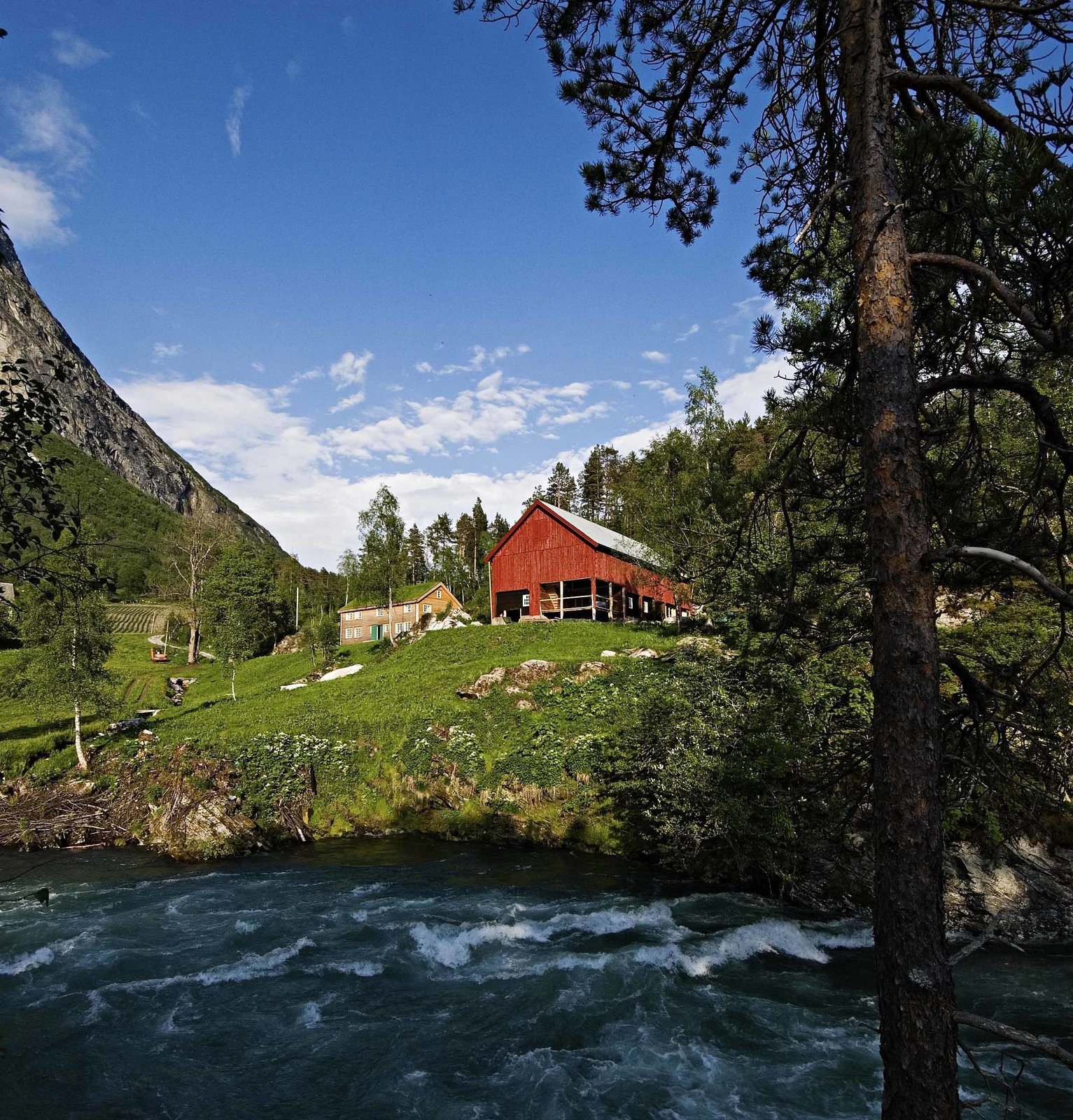 The Juvet is tucked into the woodsy corner of a classic Norwegian farm on the banks of the rushing Valldola River. The farm has existed here since at least the 1500s. Rustic Cabins Comprise This Impossibly Idyllic Hotel in Norway - Photo 3 of 8