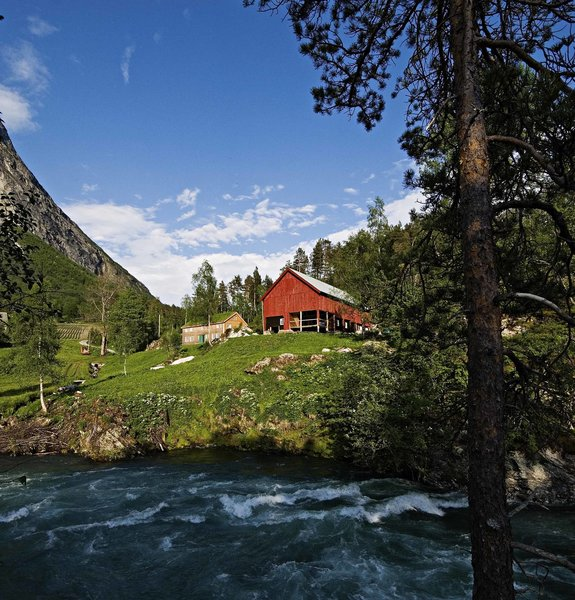 The Juvet is tucked into the woodsy corner of a classic Norwegian farm on the banks of the rushing Valldola River. The farm has existed here since at least the 1500s.