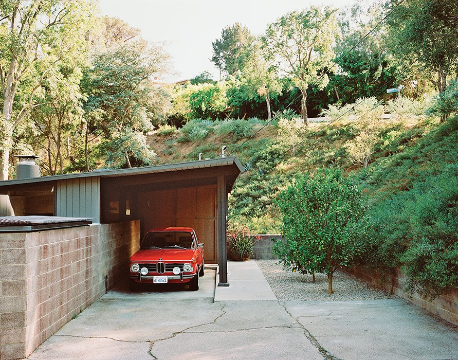The carport leads to the entrance.