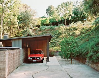 L.A. Renovation Respects Midcentury Bones (While Adding Some Flair) - Photo 3 of 15 - The carport leads to the entrance.