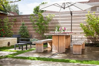 25 Blissful Backyards - Photo 10 of 25 - Since Portland is at roughly the same latitude as Sapporo, Japan, Howells was inspired by minimalist Japanese gardens. All of the wood used in the space, including the furniture, is designed to weather to a silver-gray shade over time.