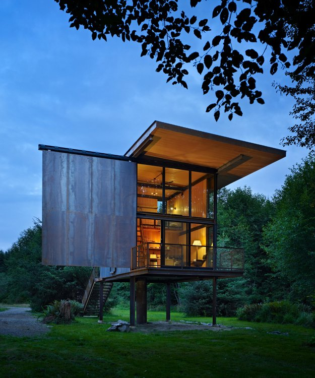 At just 350 square feet, this remote cabin with a view for the Sol Duc River sits on stilts to protect it from flooding and the dampness of the northwestern rainforest. Its shutters can be operated manually by custom steel rods.  Photo 63 of 101 in 101 Best Modern Cabins from Discover the Work of a Leading Seattle Modernist