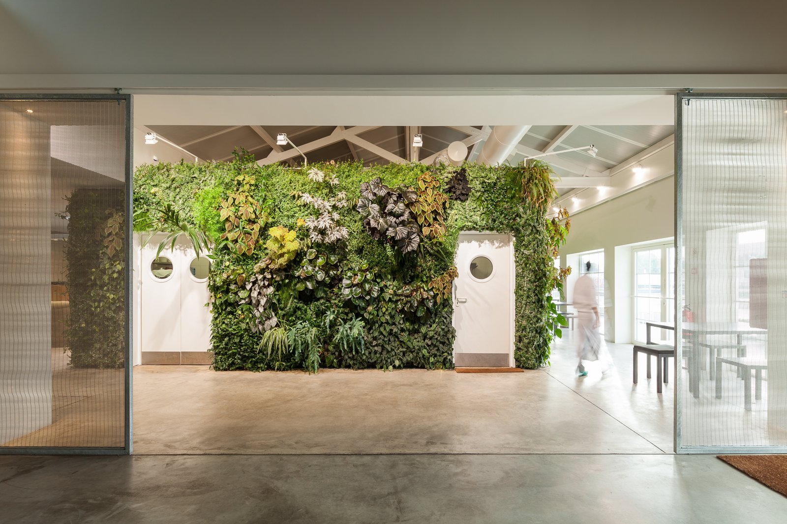 Overall, the plant wall covers over 1,200 square feet of surface area. Tagged: Doors, Interior, Metal, and Sliding Door Type.  Photo 3 of 6 in Vertical Gardens Spruce Up a Dusty Monument